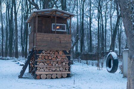 house on tree in winter garden Stock Photo