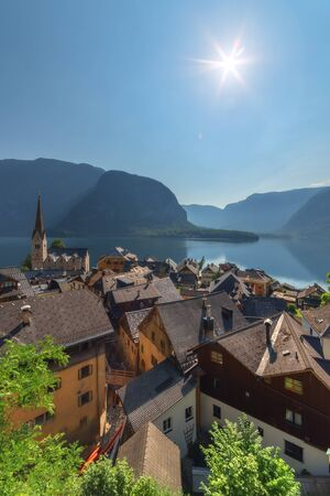austrian village: Sunny summer day in the Hallstatt village in the Austrian Alps. Maria am Berg church and Hallstattersee lake, Austria, Europe.