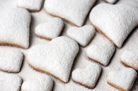 sugar cookie: heart cookie with sugar powder close up Stock Photo