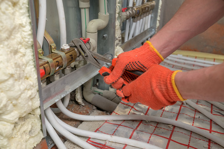 heat home: pipefitter installing system of heating