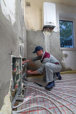 plumber: pipefitter installing system of heating