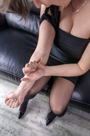 women with syringe close up Stock Photo