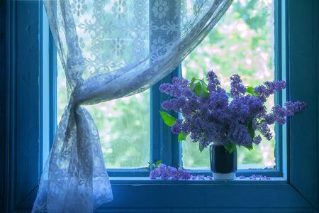 old windows: lilac flowers on old windows