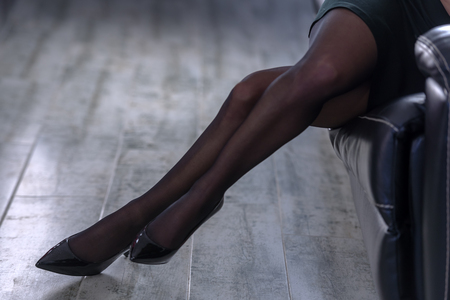 the girl in stockings: beautiful female legs close up