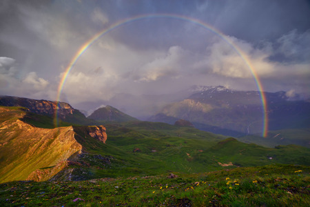 Amazing rainbow on the top of grossglockner pass, Alps, Switzerland, Europe. Banco de Imagens