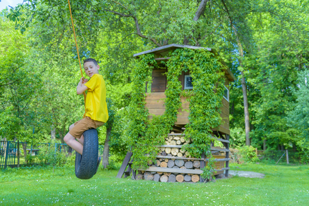 wheel house: Smiling boy on treehouse. Summer time!