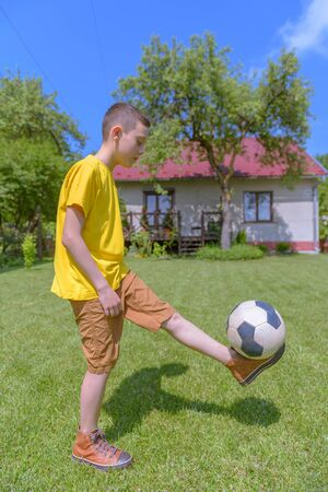 boy ball: Boy with ball on green lawn. Summer time! Stock Photo