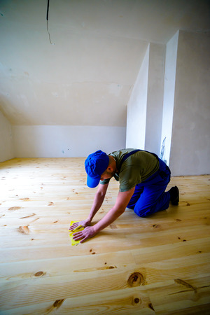emery: Wooden floor polishing, before varnished.Worker with emery.