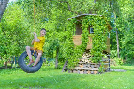 Smiling boy on treehouse. Summer time!