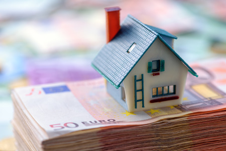 house model on euro cash stack closeup