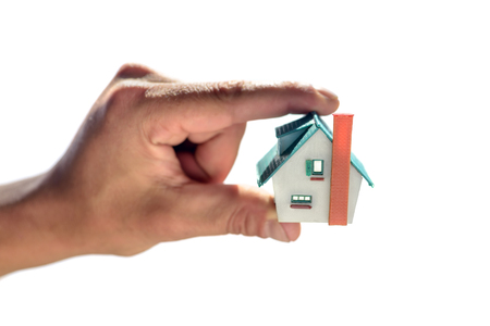 roof windows: small house in man hand