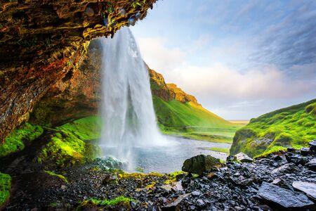 yellow stone: Sunrise on Seljalandfoss waterfall on Seljalandsa river, Iceland, Europe. Stock Photo