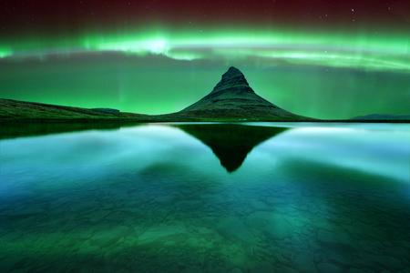 a courtesy: Green aurora light behind kirkjufell mountain in Iceland, Europe. Courtesy of NASA