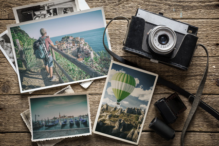 photography concept with old camera and photos Archivio Fotografico