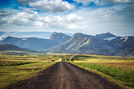 Typical Iceland landscape with road and mountains. Summer time