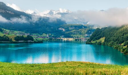 Amazing view of the Lungerersee lake in the morning mist. Lungern village, Switzerland, Europe.