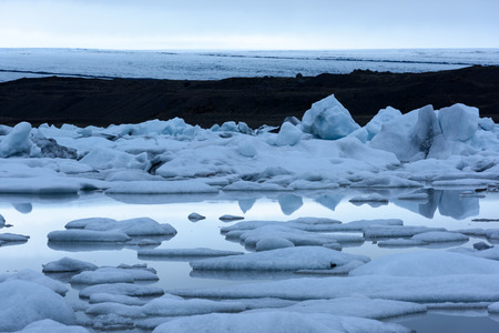 fjallsarlon: Icebergs in Fjallsarlon glacial lagoon. Vatnajokull National Park, southeast Iceland, Europe. Stock Photo