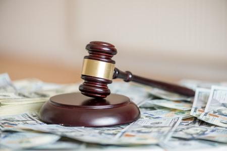 wood gavel on cash background