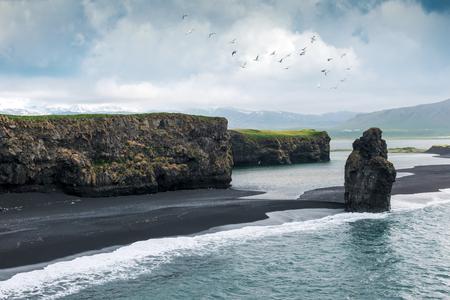rocks water: Black beach. Reynisdrangar, Vik, Iceland Stock Photo