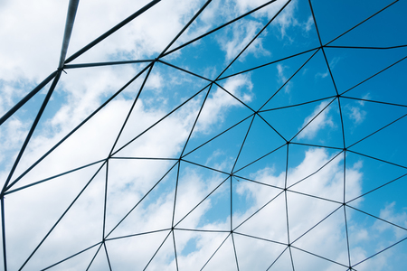 celling: Abstract celling metal construction on blue sky background. Exterior of agriculture greenhouse Stock Photo