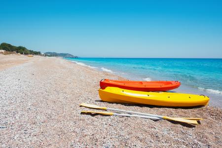 Two kayaks on sea edge. Sunny day on Mediterranean sea. Lizenzfreie Bilder