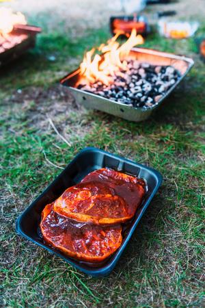 Pickled mutton steak on non-permanent foil grill closeup Lizenzfreie Bilder