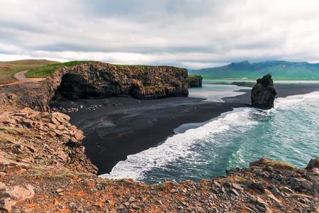 Amazing summer day on Black beach, Reynisdrangar, Vik, Iceland, Europe. Lizenzfreie Bilder