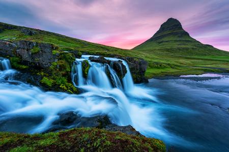 Colorful sunrise on Kirkjufellsfoss waterfall. Iceland, Europe.