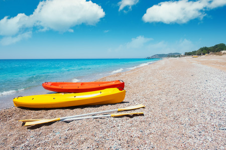 Two kayaks on sea edge. Sunny day on mediterranean sea. Summer time