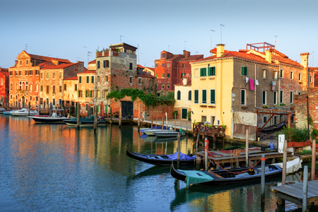Amazing view on morning Venice. Row of boats and glowing colourful houses. Italy, Europe Stock Photo