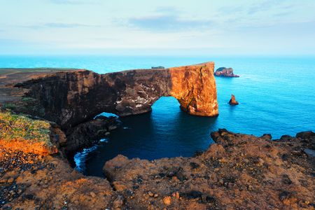 Unique basalt arch on Dyrholaey Nature Reserve, Iceland, Europe.