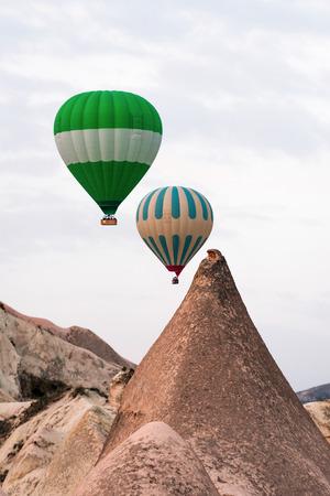 Two balloon silhouette in the sunrise sky. Cappadocia, Turkey