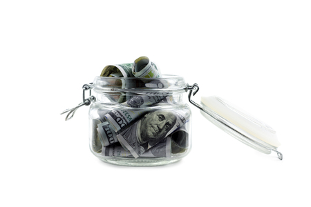 American dollars cash in glass jar isolated