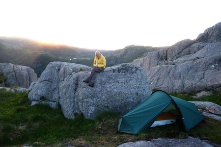 Alone tourist near his tent