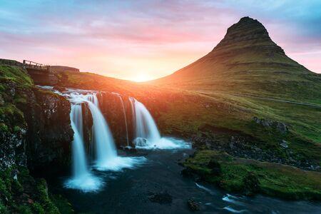 Colorful sunrise on Kirkjufellsfoss waterfall