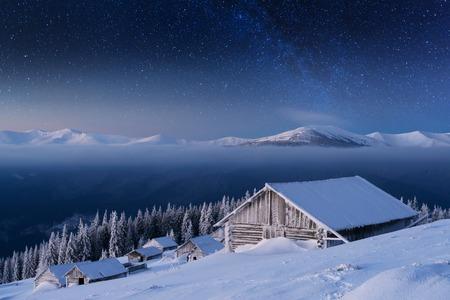 Night landscape glowing by milky way