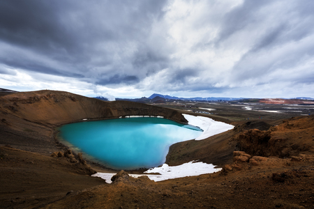 Acid hot lake in the geothermal valley Leirhnjukur Stock Photo