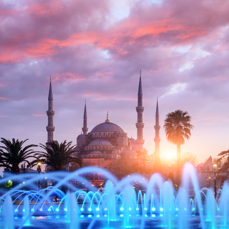 Fountain on Sultanahmet area in evening time. Multicolored streams against the background of the Blue mosque. Located place: Istambul, Turkey Stock Photo