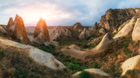 Amazing sunrise in Cappadocia mountains, Turkey. Travel landscape photography Standard-Bild
