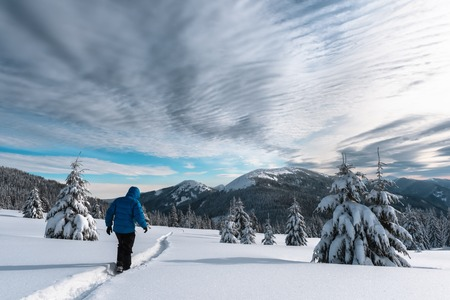 Alone tourist in the high mountains in winter time. Active travel concept. Carpathian mountains. Landscape photography