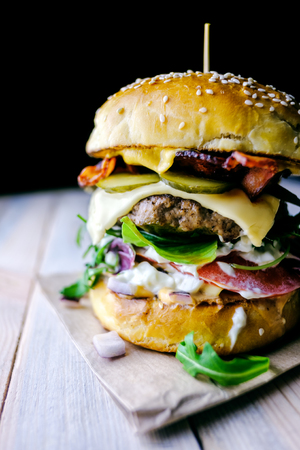 Appetizing cheeseburger on wooden table. Flat lay. Food photography