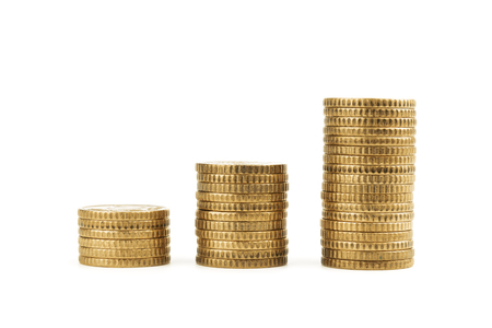 Graph from gold coins isolated on white background. Business finances concept