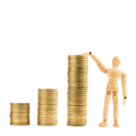 Graph from gold coins with wooden model toy isolated on white background. Business finances concept