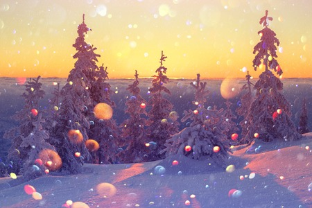Fantastic orange winter landscape in snowy mountains glowing by sunlight.