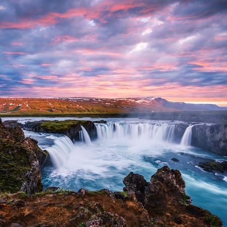 Colorful sunrise on Godafoss waterfall on Skjalfandafljot river, Iceland
