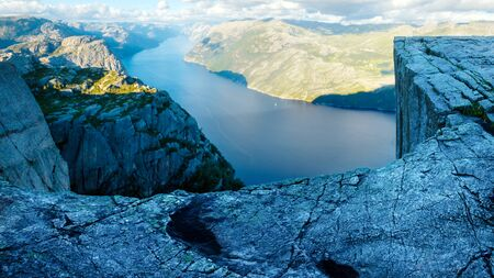 Amazing view on Preikestolen rock in Norway with Lysefjord fjord on backgrond Standard-Bild - 130760061