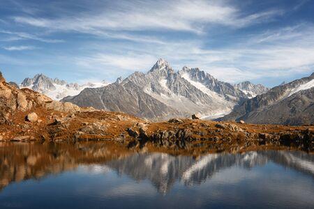 Sunny day on Chesery lake (Lac De Cheserys) in France Alps. Monte Bianco mountain range on background. Vallon de Berard Nature Preserve, Chamonix, Graian Alps. Landscape photography