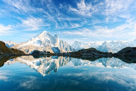 Incredible view of clear water and sky reflection on Lac Blanc lake in France Alps. Monte Bianco mountains range on background.
