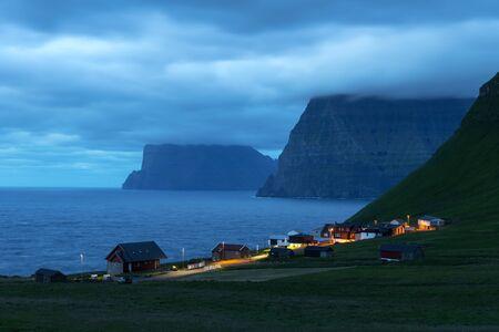 Small village of Trollanes near Kallur lighthouse on Kalsoy island in evening time, Faroe Islands, Denmark. Landscape photography 版權商用圖片