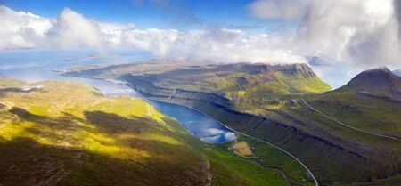 Foggy morning view of Kaldbaksfjordur fiord and Kaldbaksbotnur village from popular tourist point - Sornfelli, Streymoy island, Faroe Islands, Denmark. Landscape photography 版權商用圖片